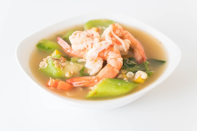 Thai spicy mixed vegetable soup with prawns Free Photo