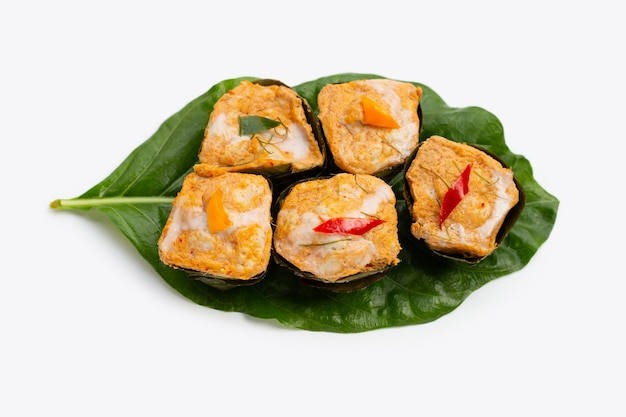 Thai streamed fish curry in banana leaves.