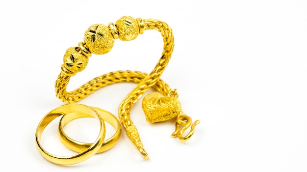 Thai style gold jewelry bracelet and couple gold ring isolated on white with copy space