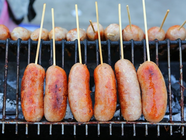 Thai style grilled sausage on hot stove
