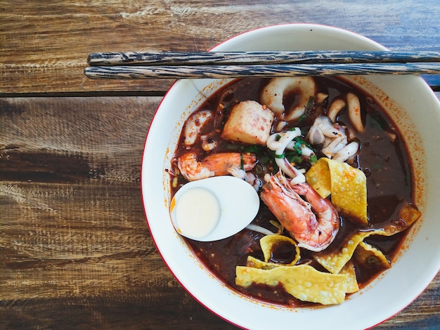 Thai style sea food spicy noodle soup