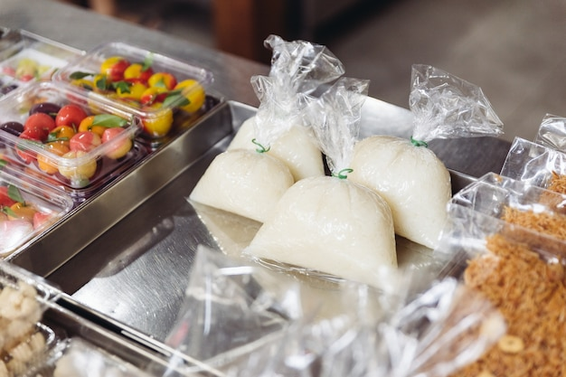 Thai sweet sticky rice wrap in plastic, ready to sell.