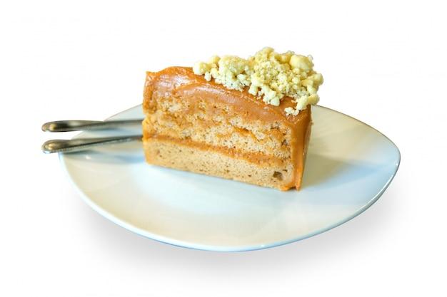 격리 된 흰 배경에 치즈와 함께 태국 차 케이크 토핑