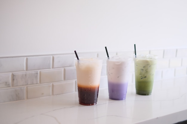 Thai tea, taro milk tea, matcha green tea on the white background