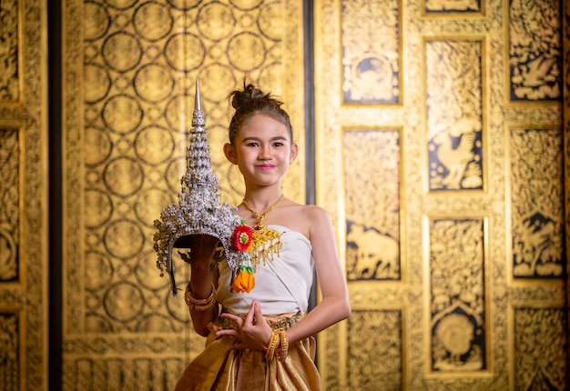 Thai traditional dress. young kid actors performs thai ancient dancing art of thai classical dance in thailand