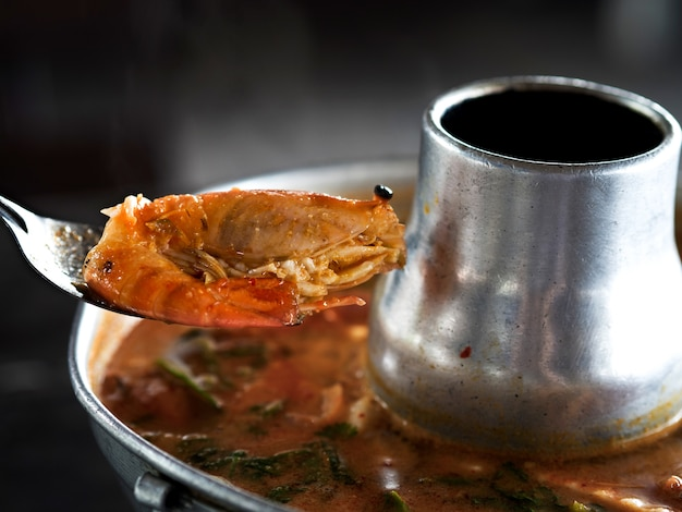 Thai traditional menu, tom yum kung, spicy and sour soup with shrimps