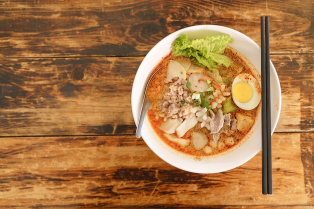 Thai traditional spicy seafood noodles or tom yum