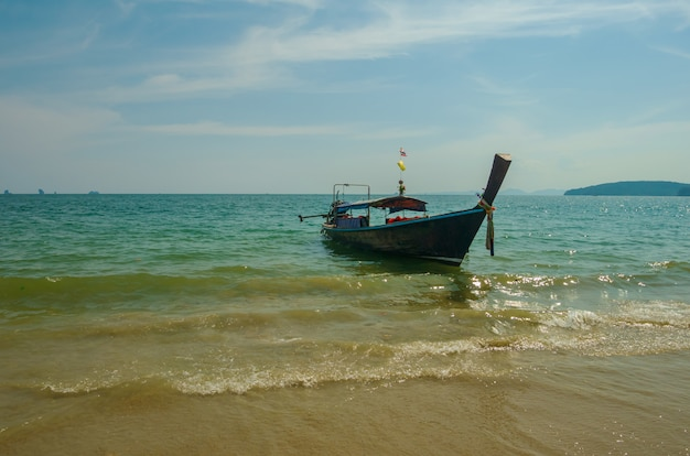 Thai traditional wooden long tail boat beach sand  ao nang, krabi, thailand