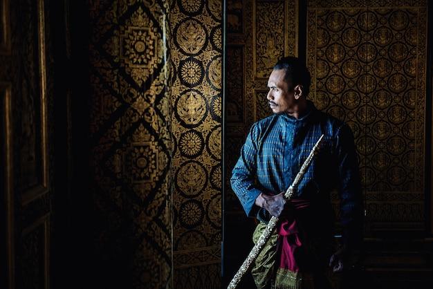 Thai warrior in traditional at ayutthaya historical park in ayutthaya, thailand
