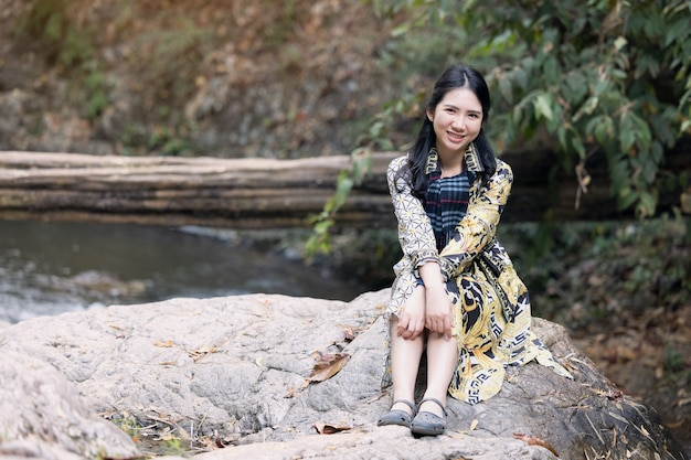 Thai woman traveler travel into amazing beautiful  in tropical forest