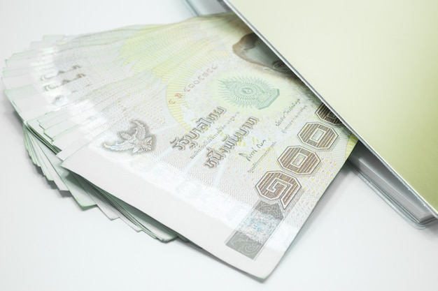 Thailand banknotes arranged in set and note book