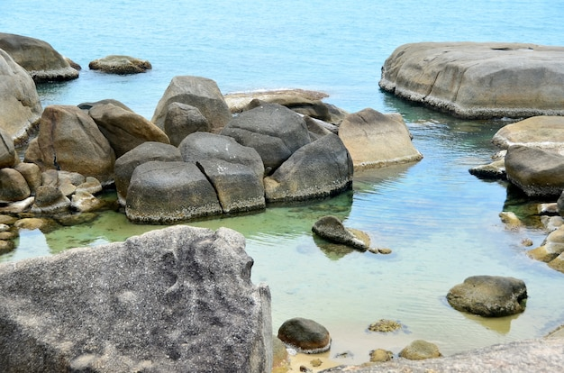 Thailand beach. large stones and clear water.