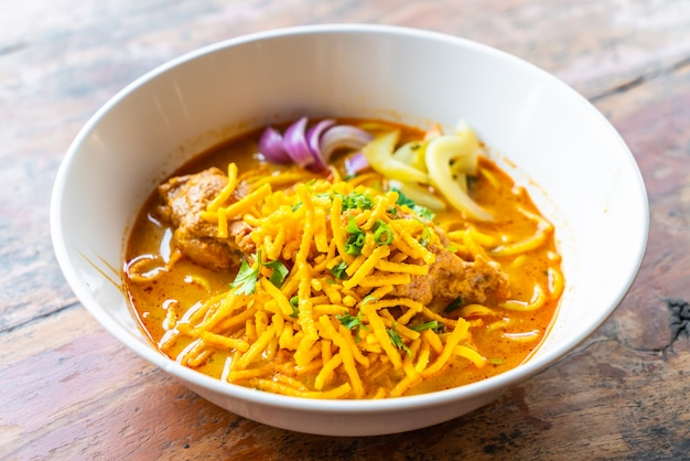 Thailand northern style curried noodle soup with chicken
