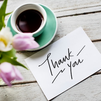 Thank you card and a cup of coffee