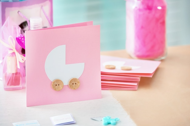 Thank you cards for baby shower party on wooden table