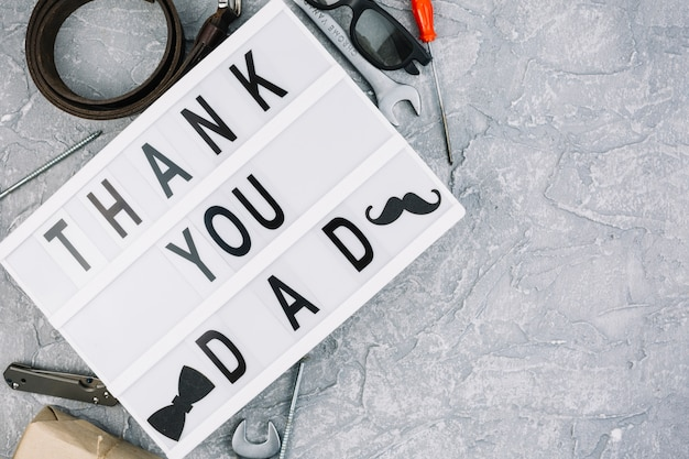 Thank you dad inscription on tablet near male accessories