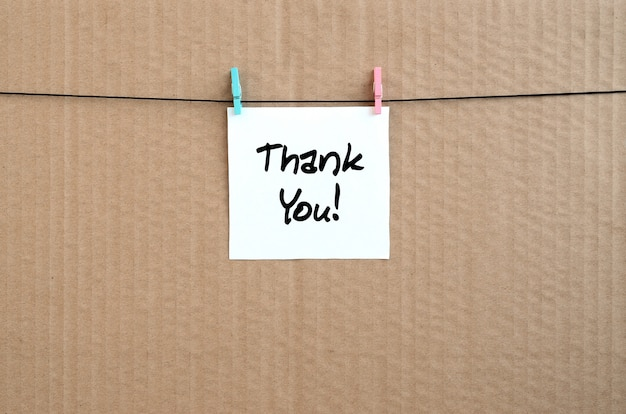 Thank you! note is written on a white sticker that hangs with a clothespin