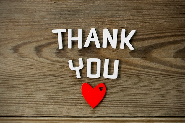 Thank you word - isolated text of gratitude with red heart.