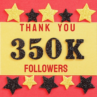 Thanks 350k, 350000 followers. message with black shiny numbers on red and gold