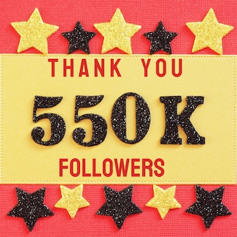 Thanks 550k, 550000 followers. message with black shiny numbers on red and gold
