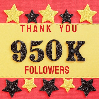 Thanks 950k, 950000 followers. message with black shiny numbers on red and gold