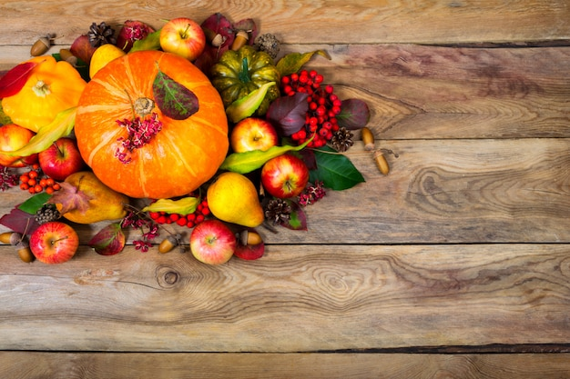 Thanksgiving arrangement with pumpkin, apples, pears, rowan berries, .