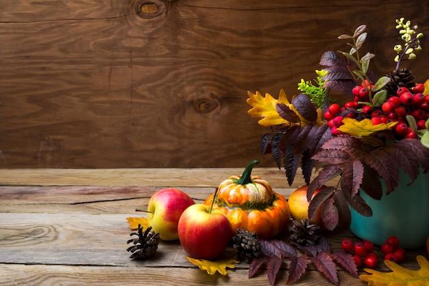 Thanksgiving arrangement with rowan in turquoise vase,