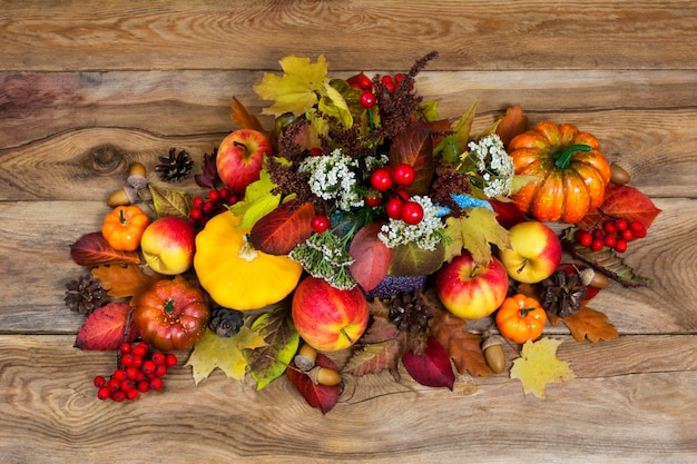 Thanksgiving arrangement with white flowers and colorful fall leaves
