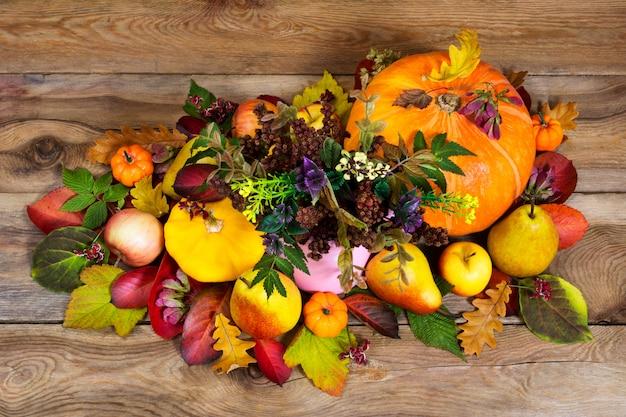 Thanksgiving arrangement with wild flowers, pumpkins, apples, pears