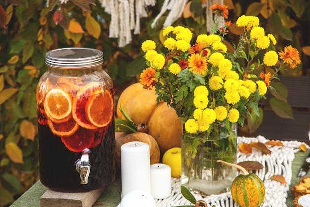 Thanksgiving autumn dining table decor in the garden.