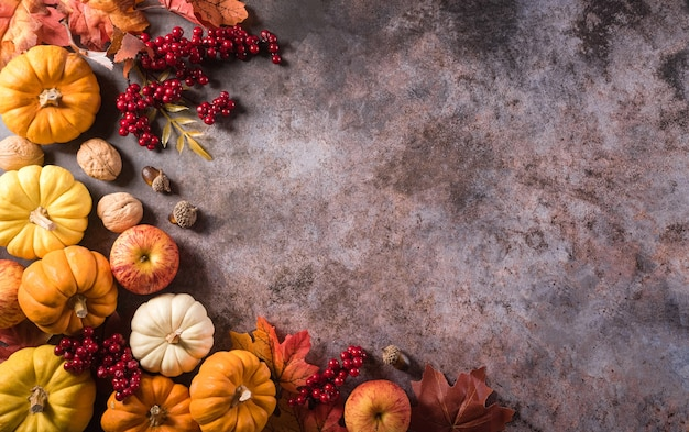 Thanksgiving background concept with fall leaves pumpkin and seasonal autumnal decor