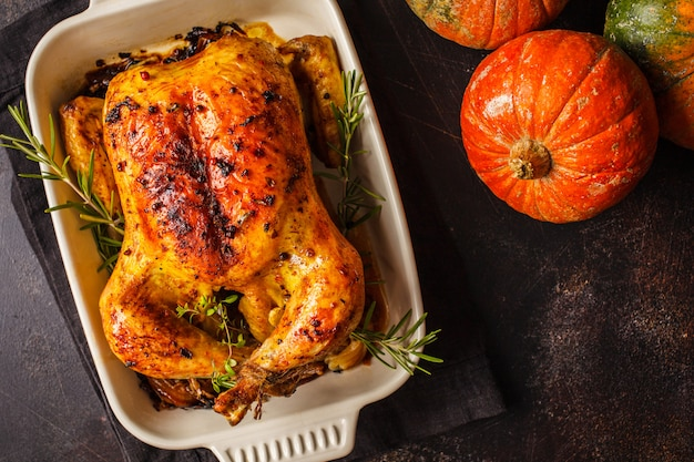 Thanksgiving baked chicken with spices and herbs. thanksgiving concept.