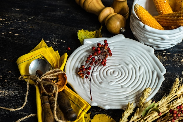 Thanksgiving day or autumnal harvest concept with frame with nuts, berries, vegetable and fruits on dark wooden surface with copy space