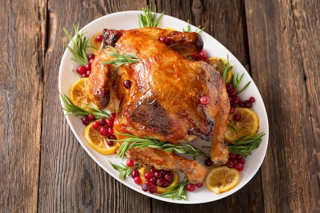Thanksgiving day traditional dish baked turkey. christmas dinner on dark rustic surface, top view