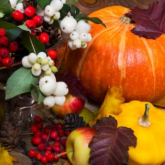 Thanksgiving decor with snowberry, pumpkin, yellow squash
