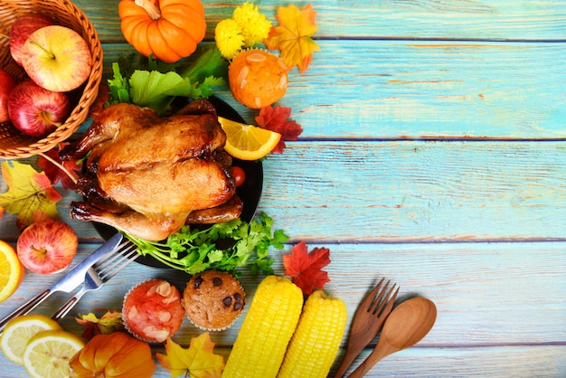 Thanksgiving dinner with turkey vegetable fruit served on holiday thanksgiving background