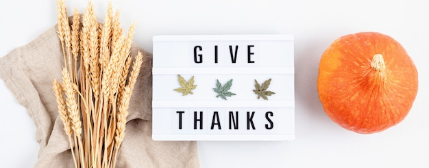 Thanksgiving flat lay composition. lightbox with the phrase give thanks. autumn holidays, fall concept. mockup, top view, copy space