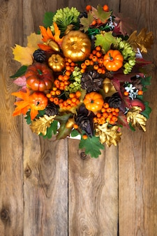 Thanksgiving front door wreath with fall leaves