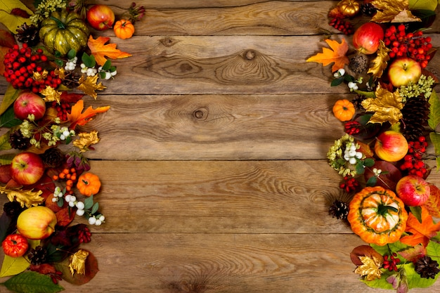 Thanksgiving greeting with frame of pumpkins, apples, berries and leaves