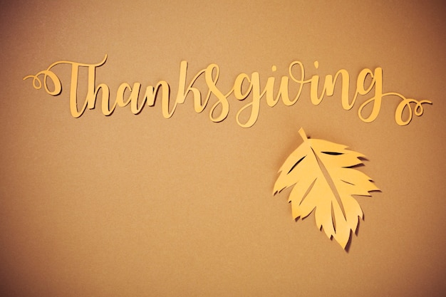 Thanksgiving lettering with big leaflet