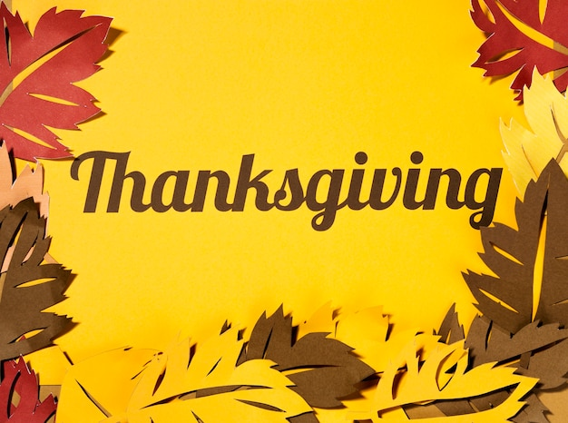 Thanksgiving lettering with big leaflets on paper