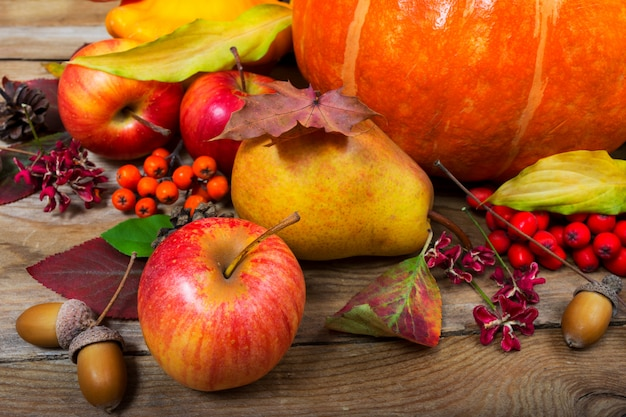 Thanksgiving  with apples, pear, fall leaves and acorns.