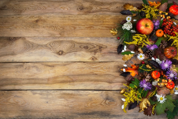Thanksgiving  with autumn leaves, yellow and purple flowers