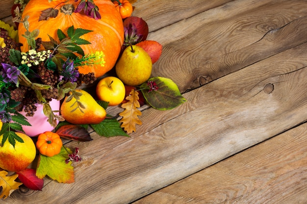Thanksgiving  with ripe pumpkin, pears and fall leaves