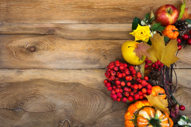 Thanksgiving wreath with pumpkins and rowan berries,