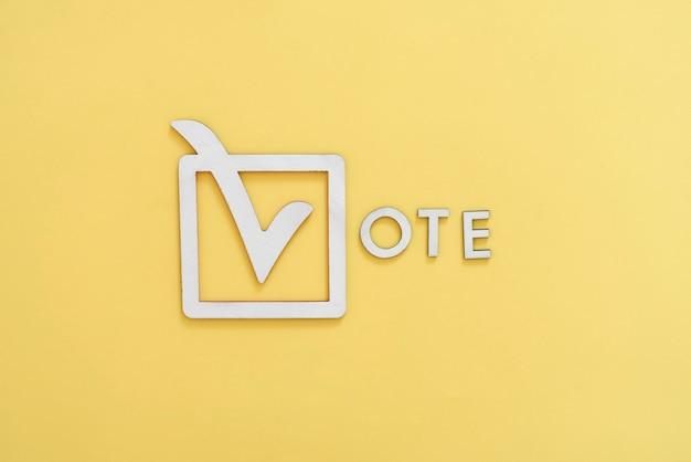 Абстрактный флажок голосовать подписать творческий значок рамки и буквы концепции демократии