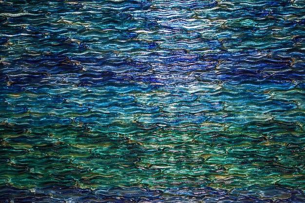 ガラスの抽象的な質感。ガラスの海の波の質感