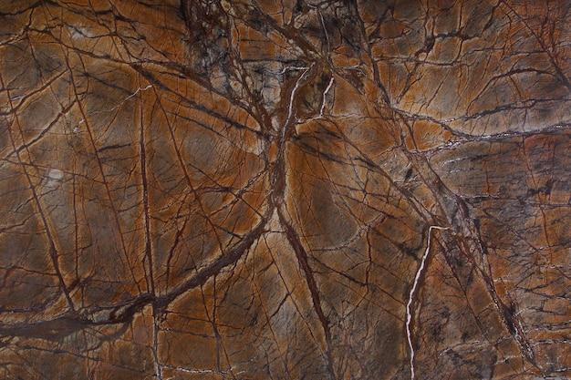 Фон натурального камня - оранжевый мрамор с интересными темными прожилками под названием bidasar brown.
