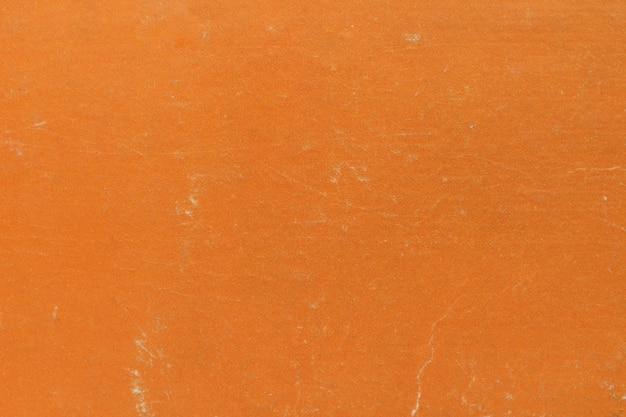 Фоновая текстура сделана из обложки книги оранжевого цвета.