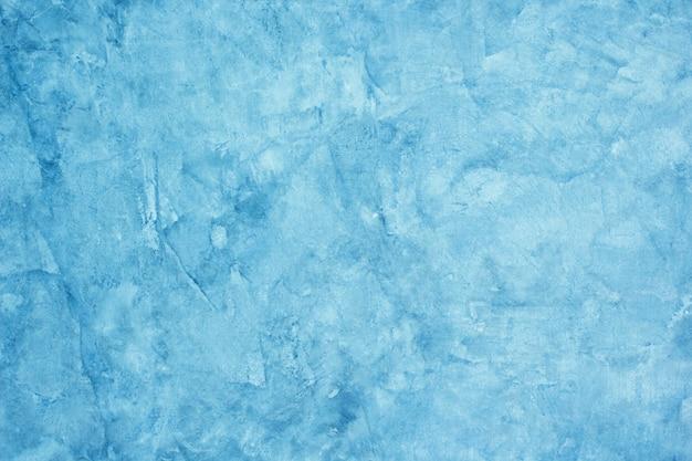 セメント石膏の背景テクスチャは生の青です。